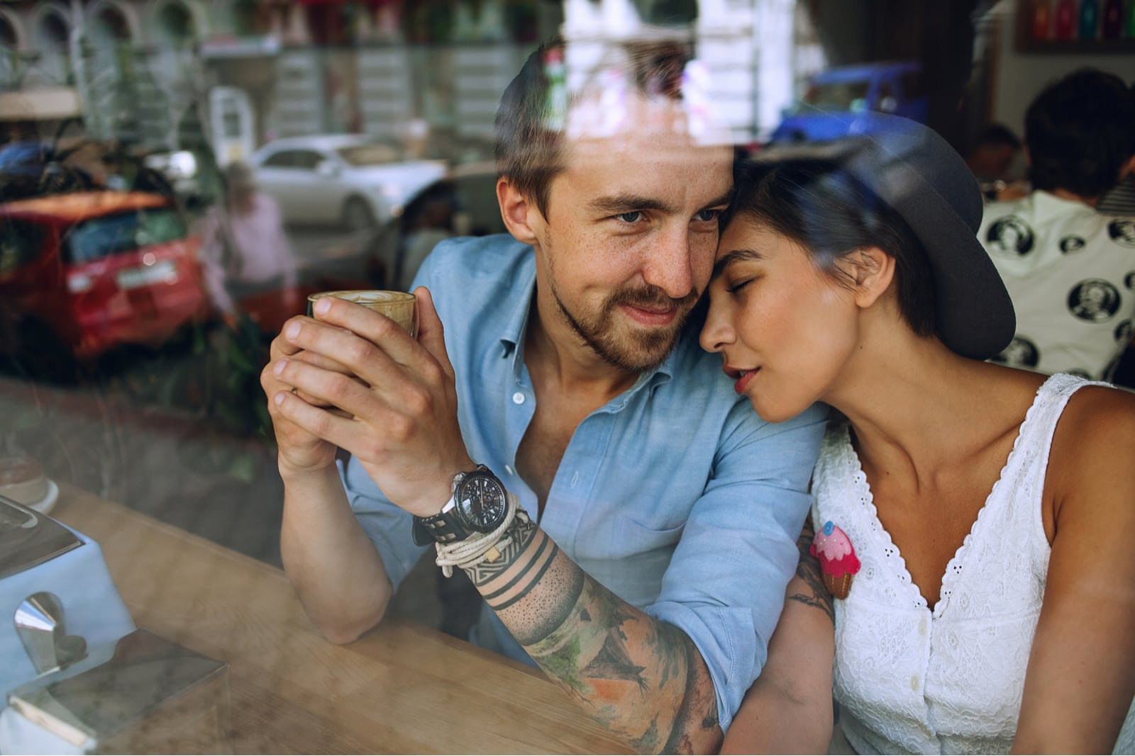 a loving couple hugging in a cafe by the window