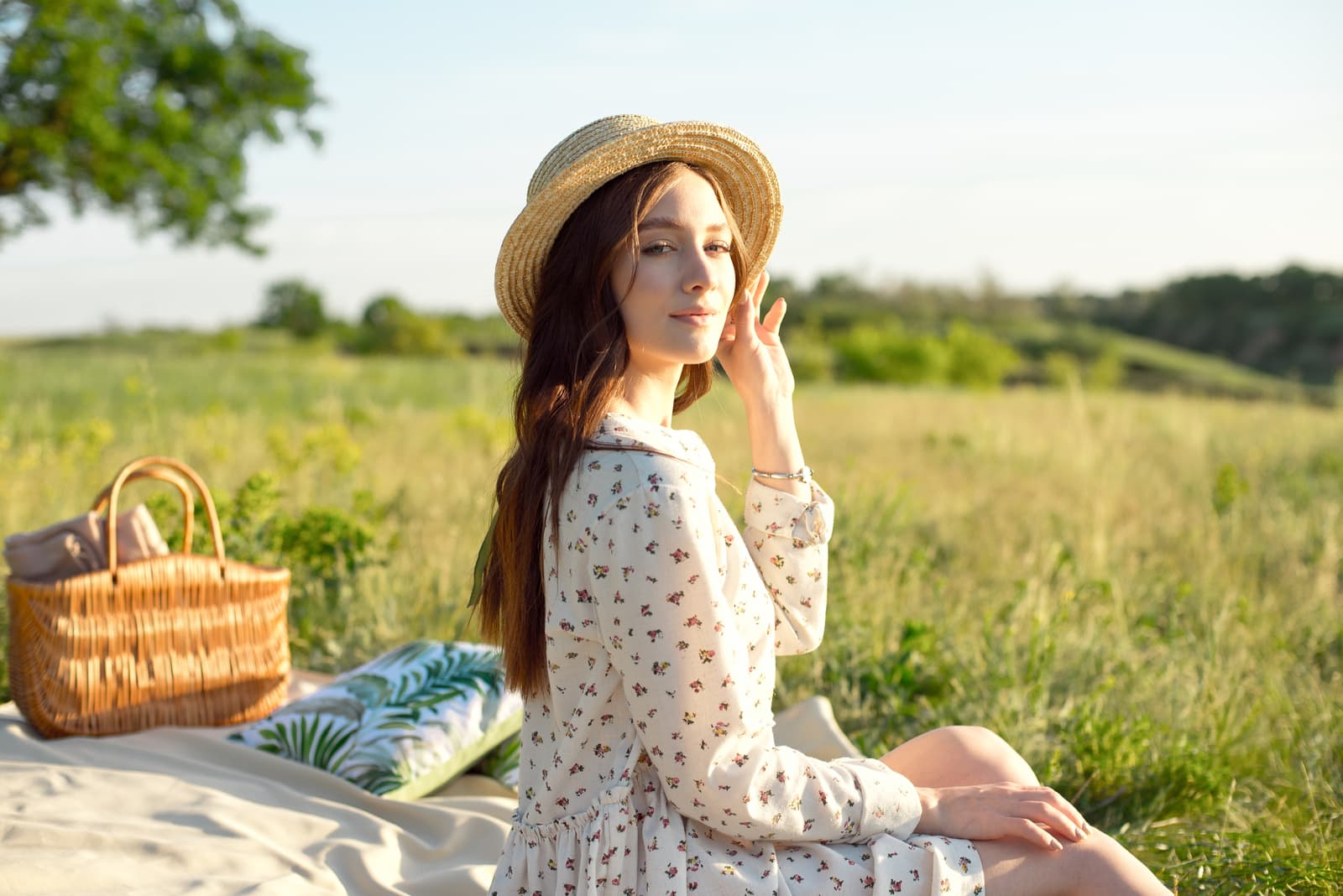 beautiful young woman sitting in nature