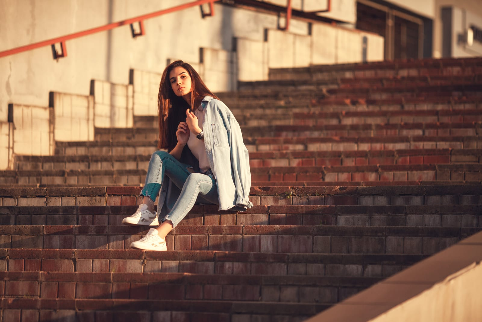 beautiful young woman sitting on stairs