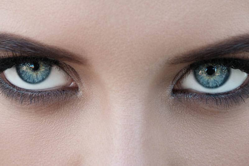 close up photo of female with blue eyes