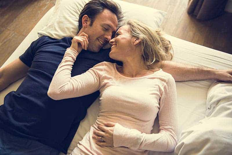 couple laying on floor and looking each other