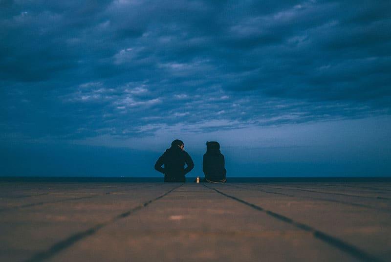couple sitting on the floor outdoor