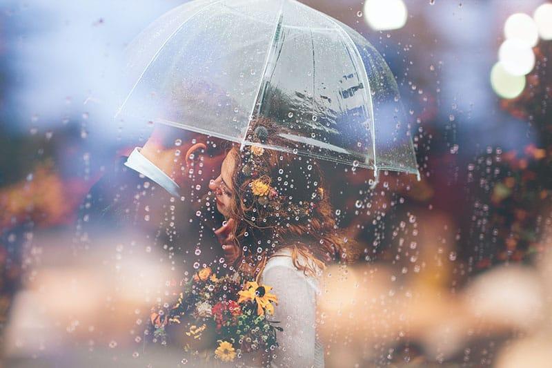 couple standing under umbrella