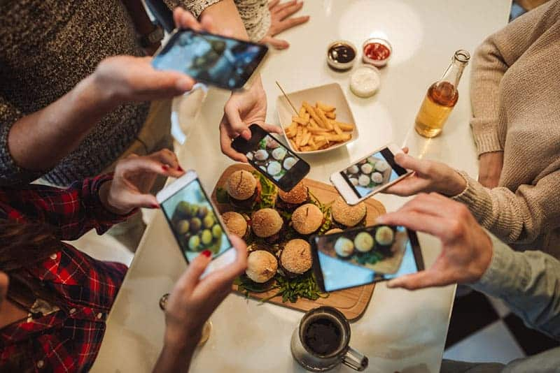 friends taking picture of food