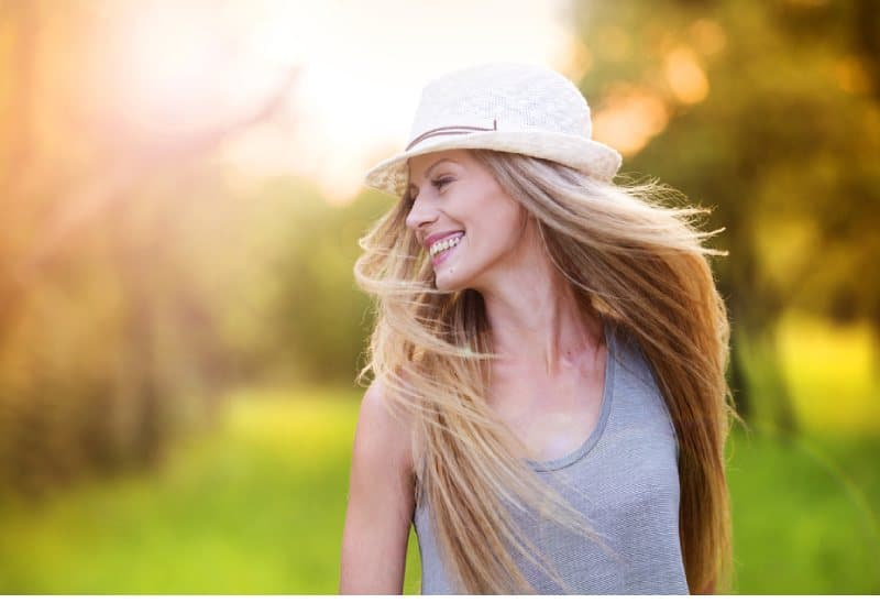 happy young girl outside smiling