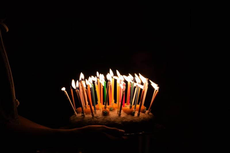 lighted candles on cake