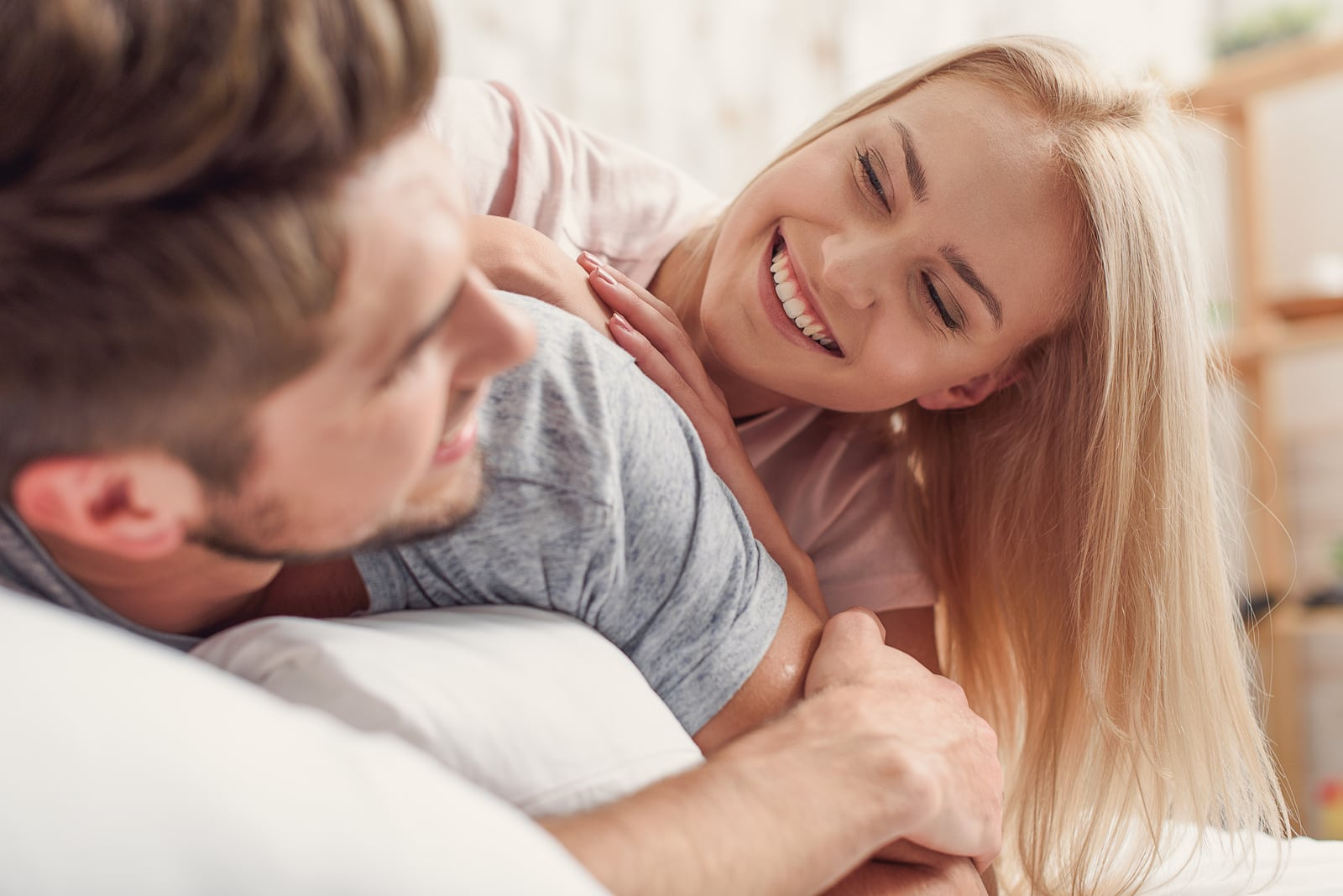 loving couple is relaxing in bed
