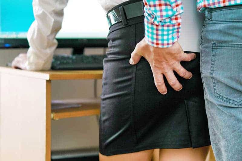 man grab woman's ass