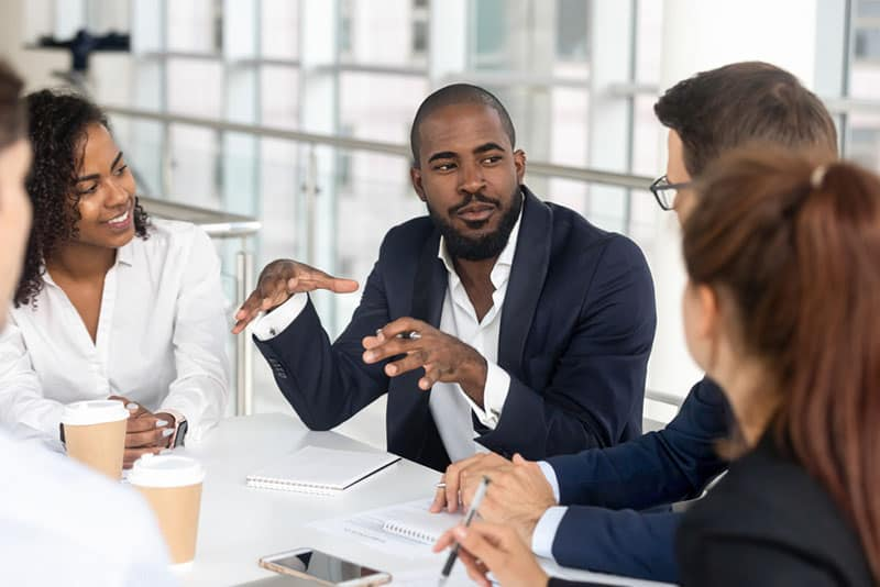 man talking to his work colleagues