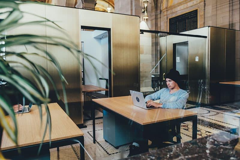 man working at his laptop