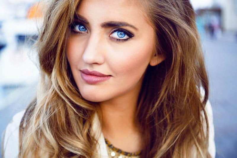 portrait of woman with big blue eyes