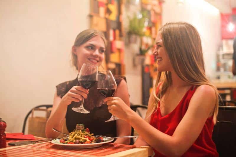 smiling female friends at restauran