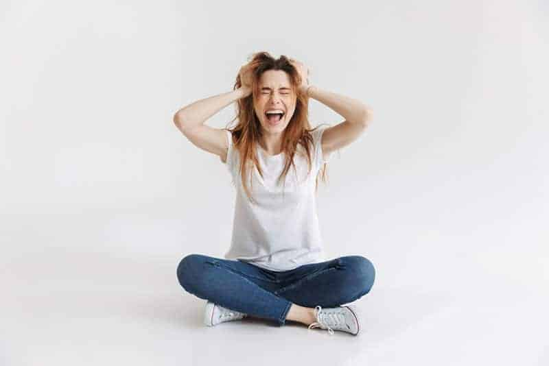 stressed woman holding for her head
