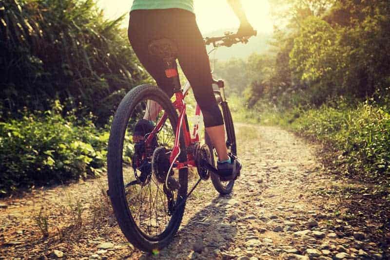 woman biking in nature