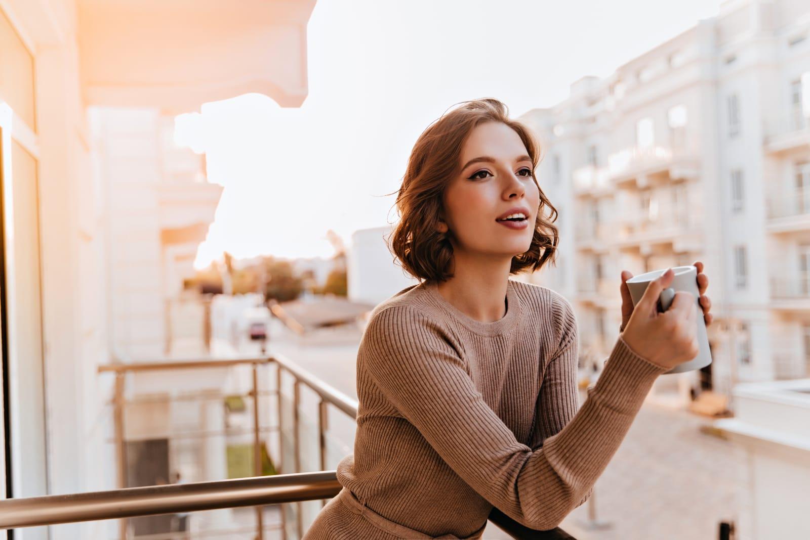 woman drinking tea at balcony
