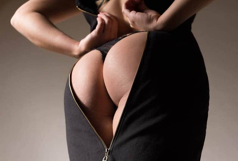 woman's butt about to zip dress