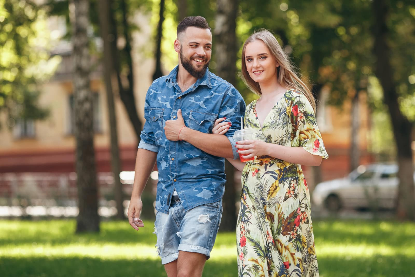 young couple in love walking in the summer park