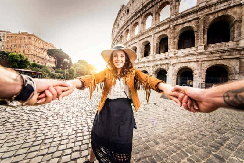 Happy tourists visiting famous places in Italy