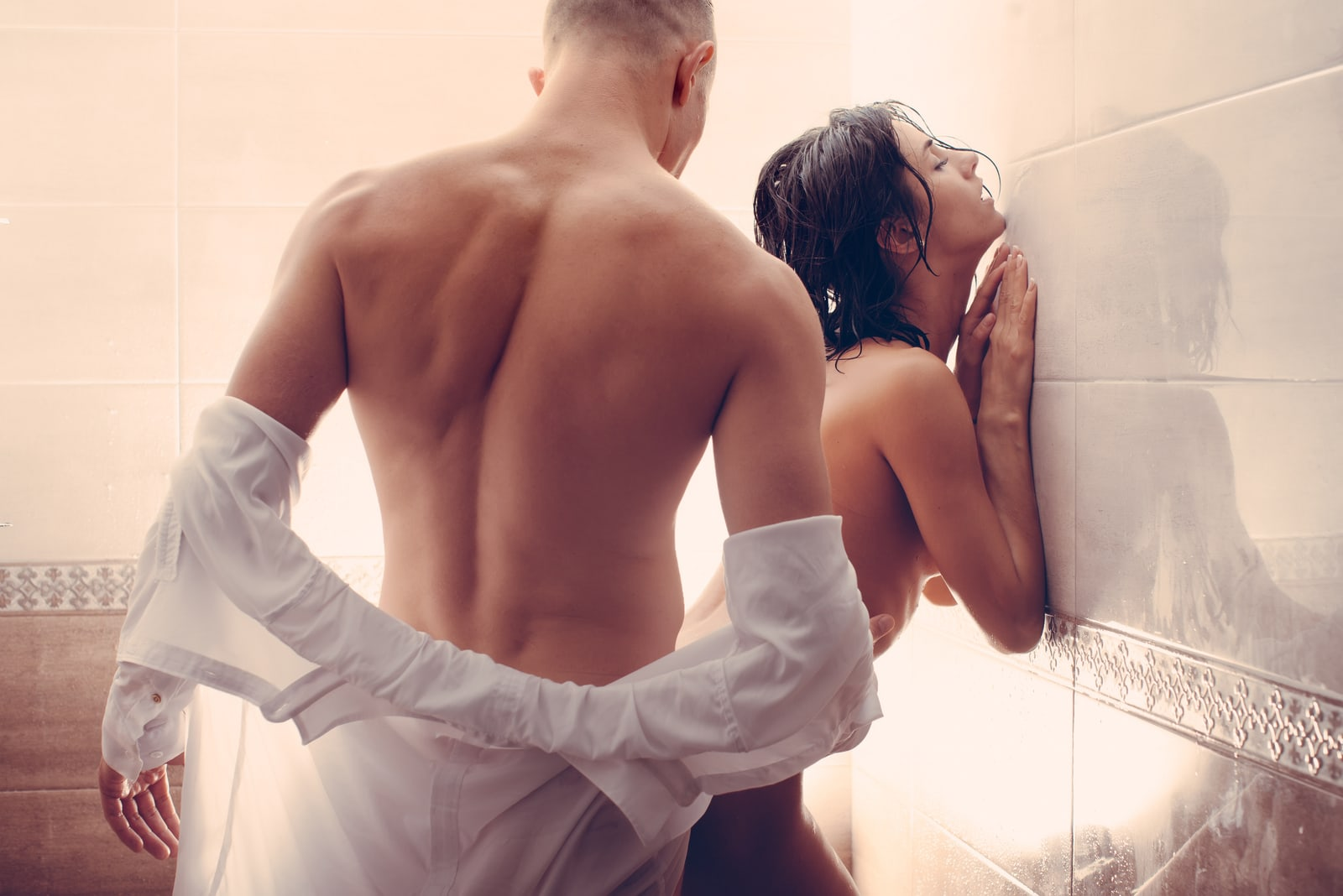 a man fucks a woman from behind