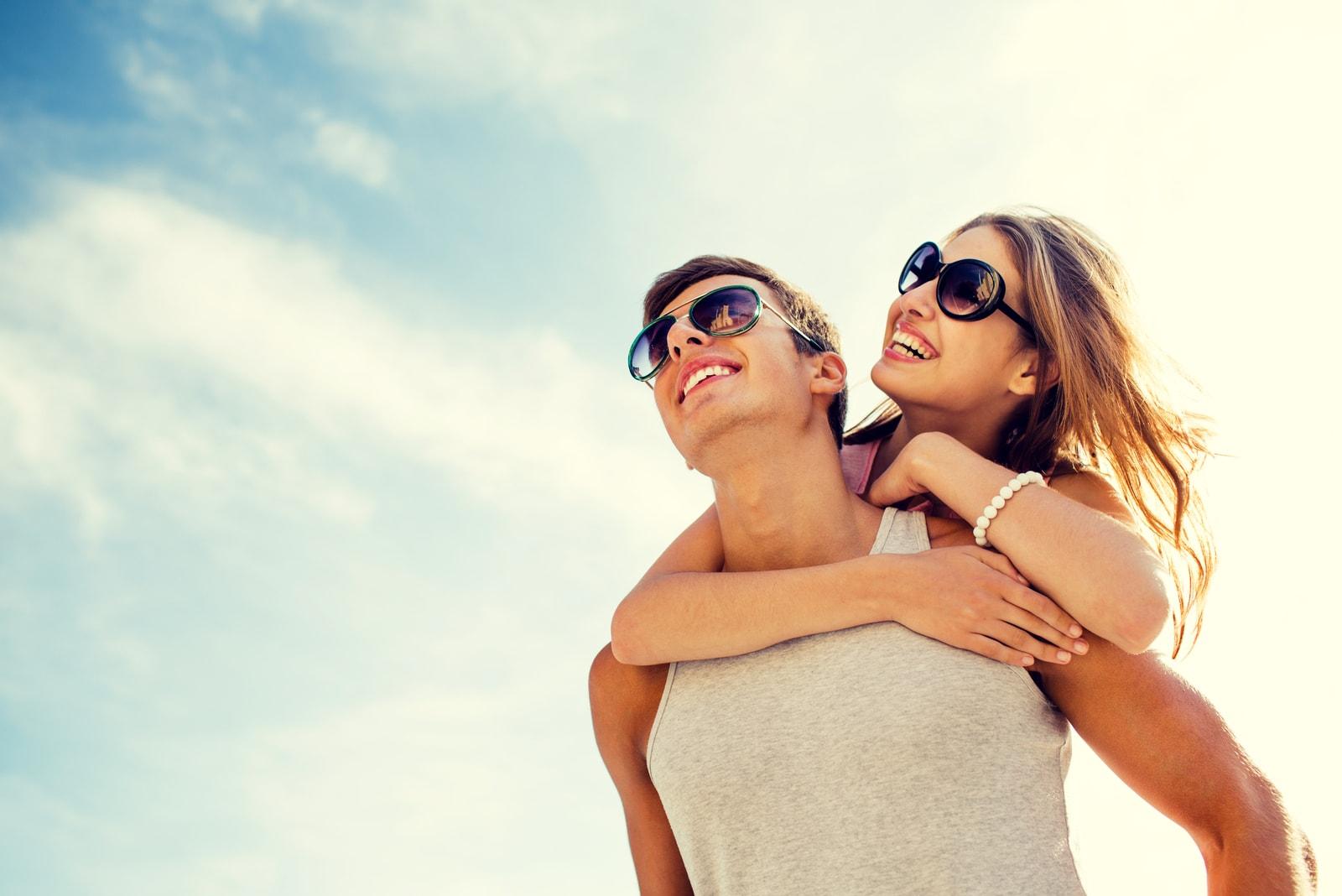 a smiling couple having fun in the sun