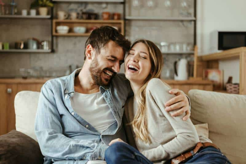 couple hugging and smiling in living room