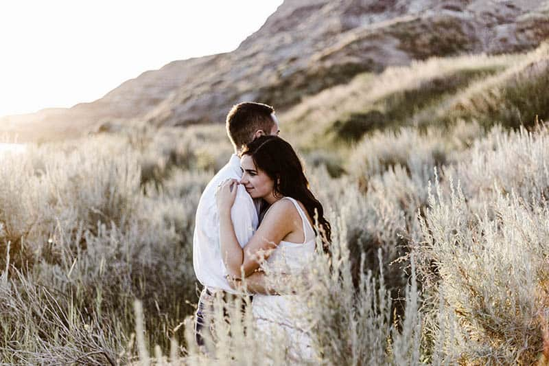 couple hugging on hill