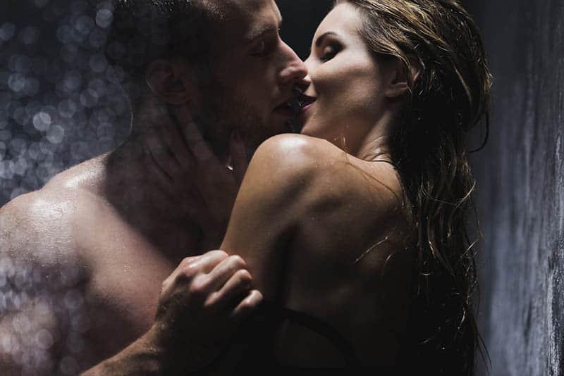 couple kissing under shower