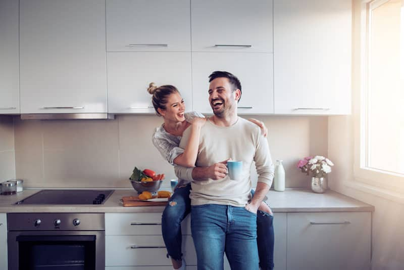 couple smiling in the kitchen