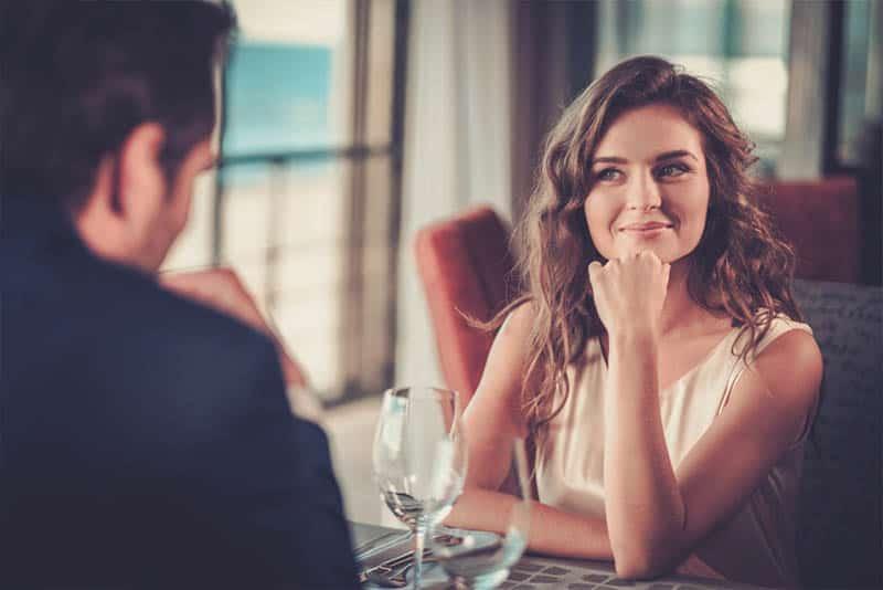 cute woman looking at man at restaurant