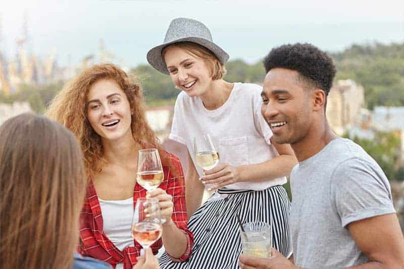 group of friends holding champagne glasses