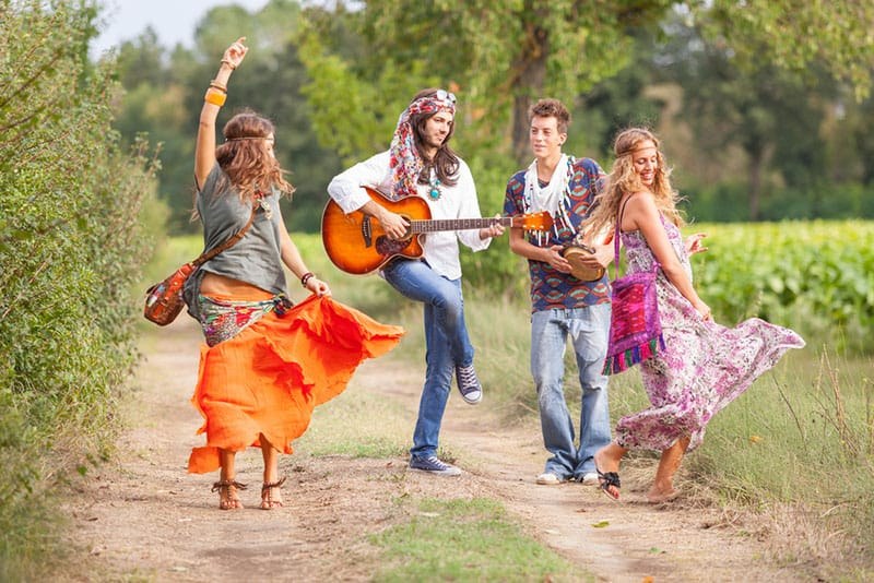 hippie group playing music and dancing