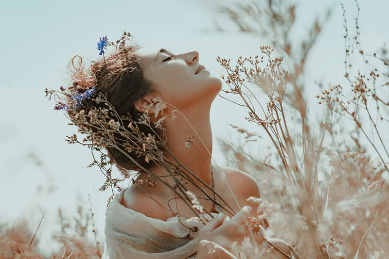 hippie woman enjoying the plants