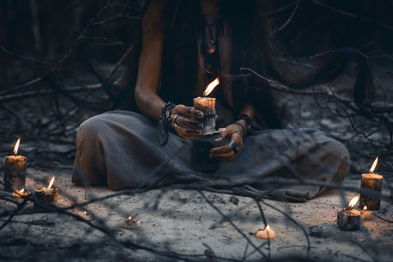 hippie woman holding candle
