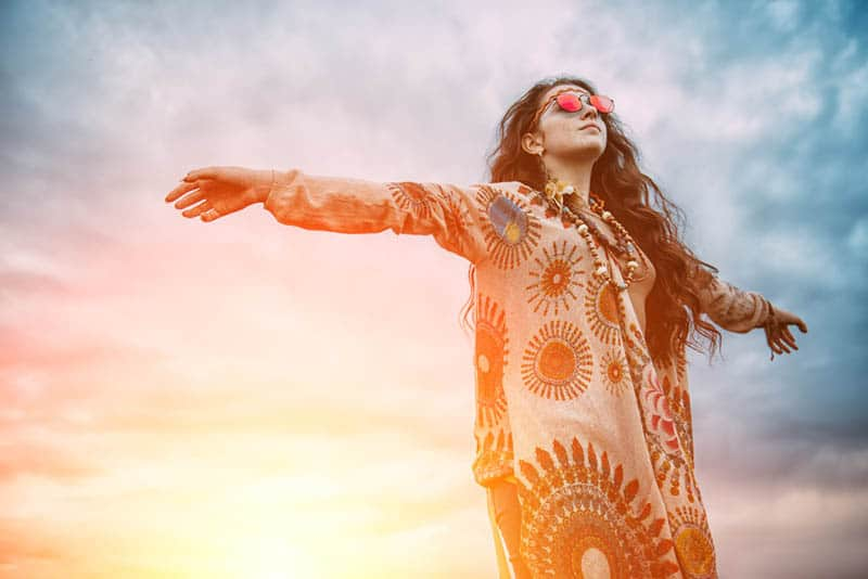 hippie woman spreading her arms
