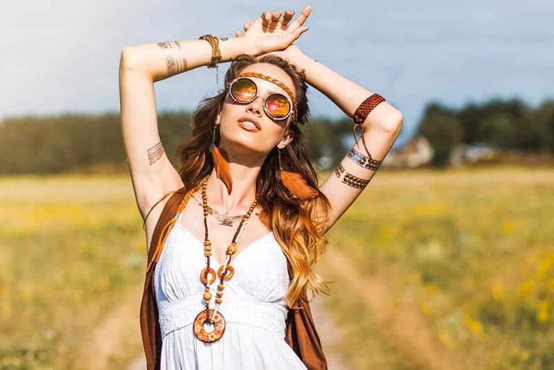 hippie woman standing in the field