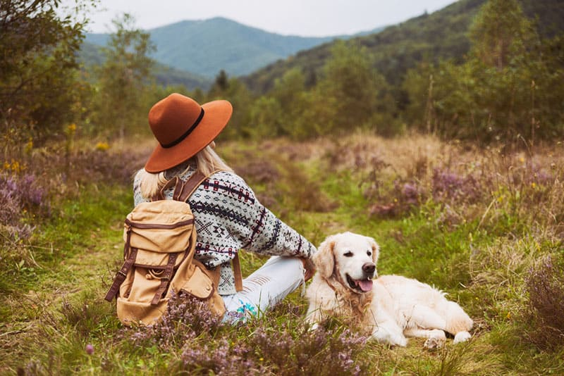 hippie woman with dog in nature
