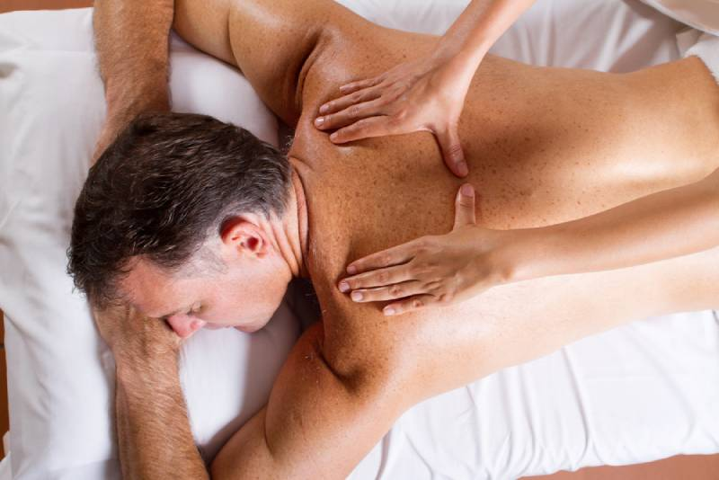 man having back massage