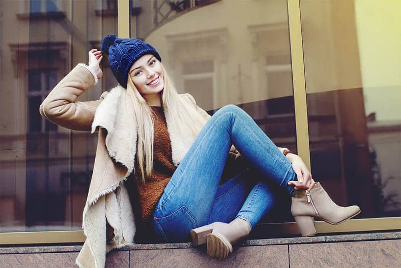 Full body portrait of young beautiful happy smiling girl posing on street