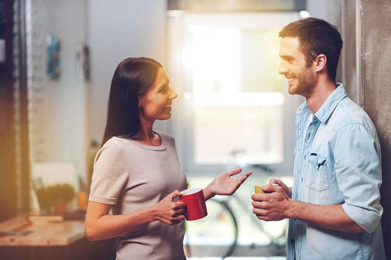 smiling man and woman talking