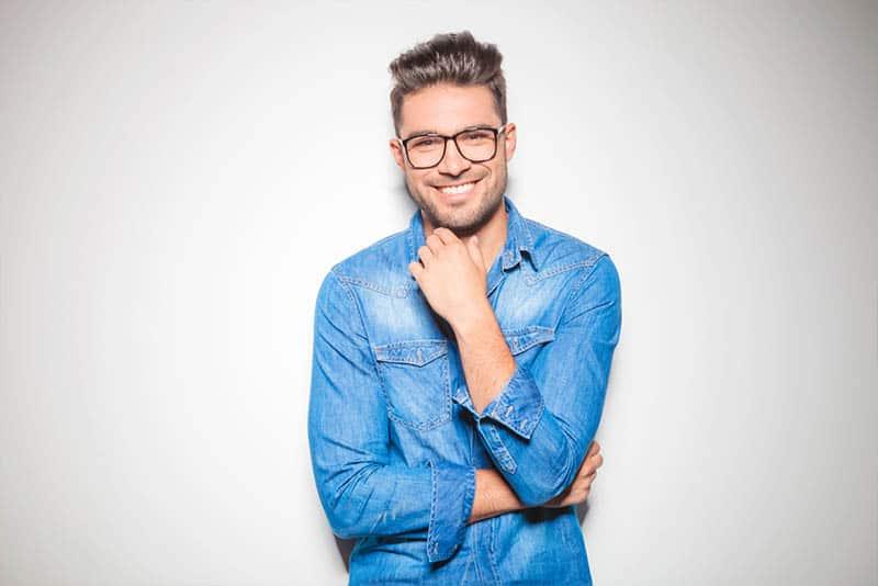 smiling man wearing eyeglasses and blue shirt