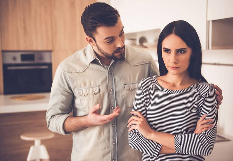 upset woman doesn't want to listen her man while talking