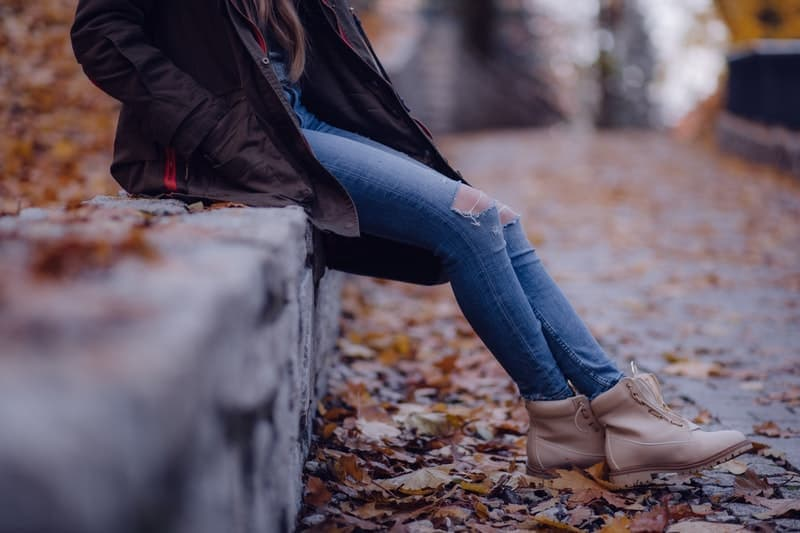 woman sitting on the wall outdoor