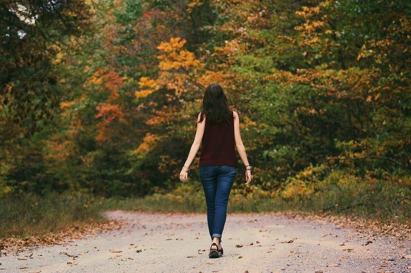 woman walking in the woods