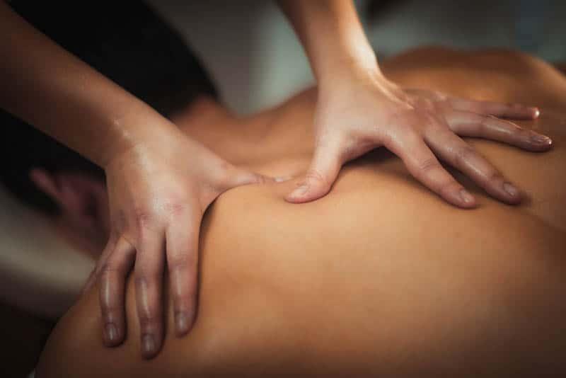 woman's hands massaging a man