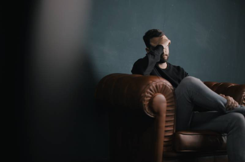worried man sitting on sofa