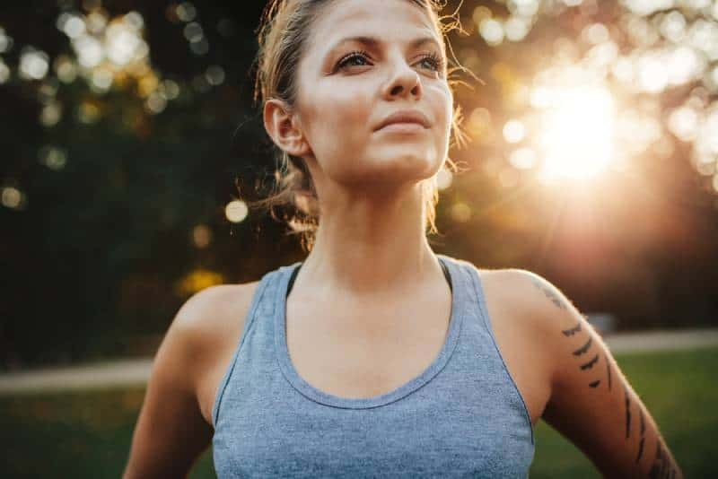 young woman in sportswear standing outdoors