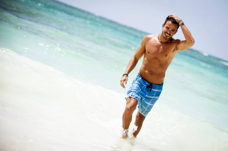 attractive young man on a tropical beach