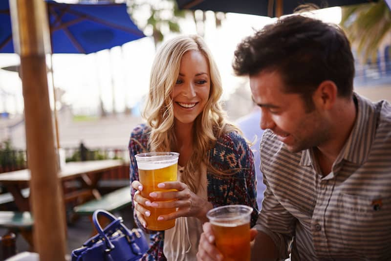 couple drinking beer at bar