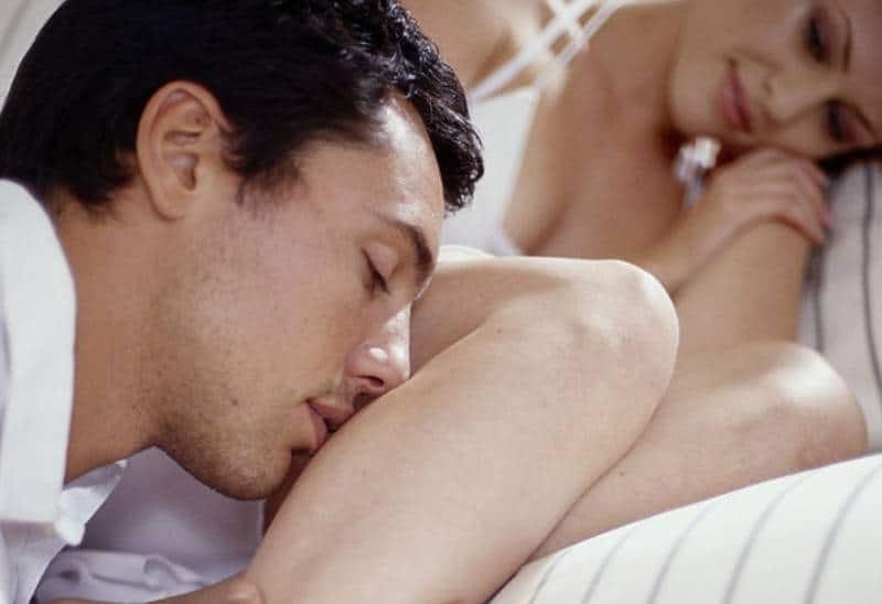 man kissing woman leg