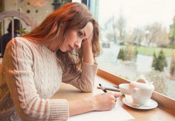 sad woman writing a letter